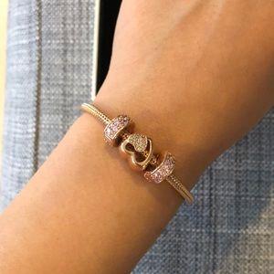 Pandora rose gold bracelet with heart charm